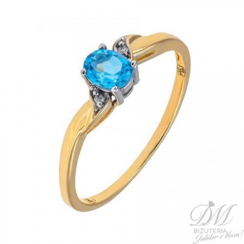Złoty pierścionek z niebieskim topazem i brylantami