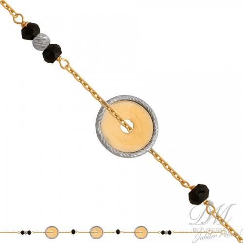 Złota bransoletka z czarnymi cyrkoniami i kółkami